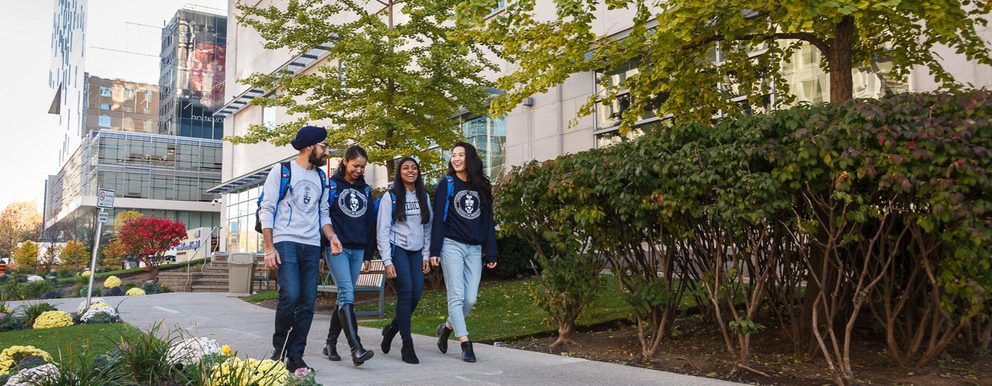 Students walk along University Avenue.