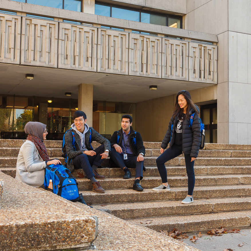 Students talk outside the Medical Sciences Building.