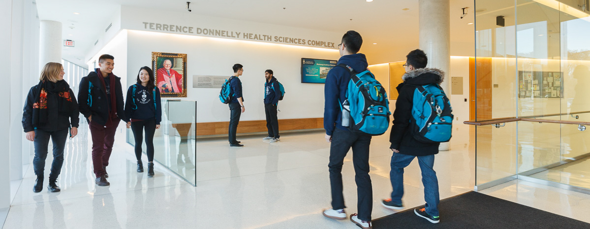 Students walk through the Terrence Donnelly Health Sciences Complex.