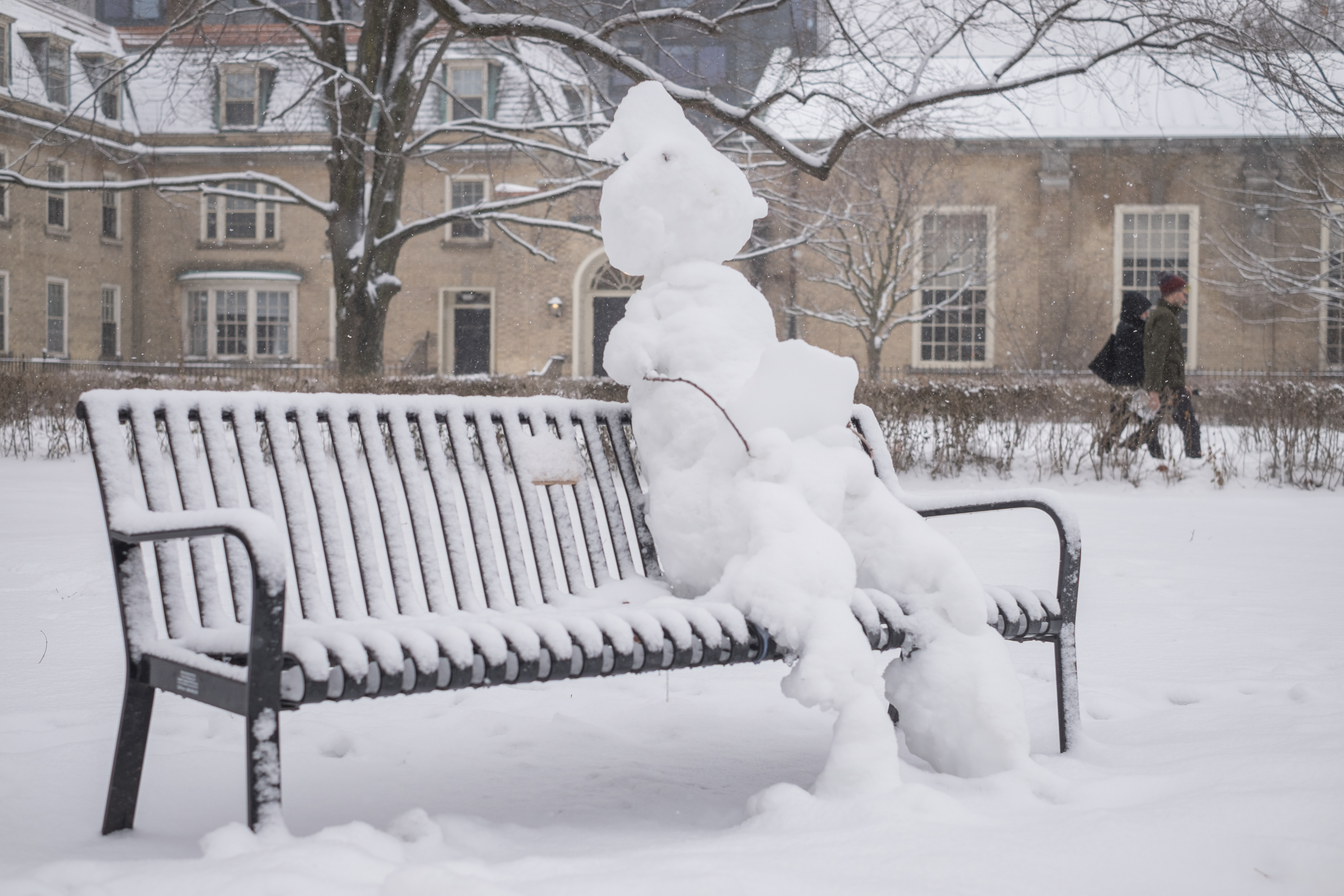 Snowman on a Bench on Campus
